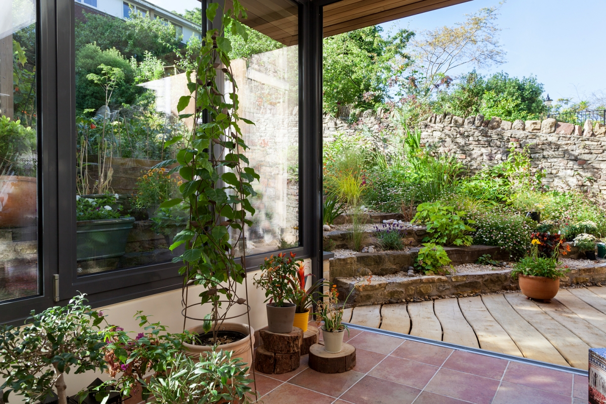 The tiered landscaped garden links seamlessly with the new Garden Room